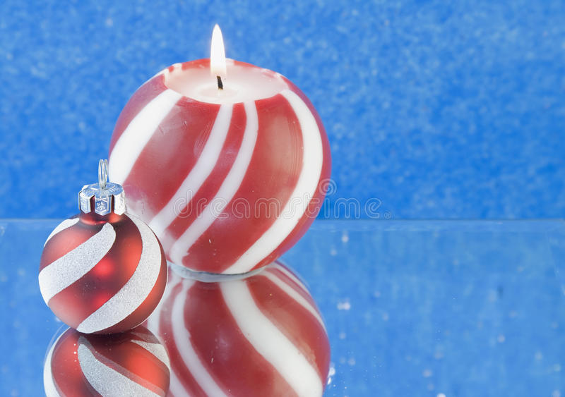 Download Red Striped Christmas Candle Blue Background Stock Photo - Image: 13307510