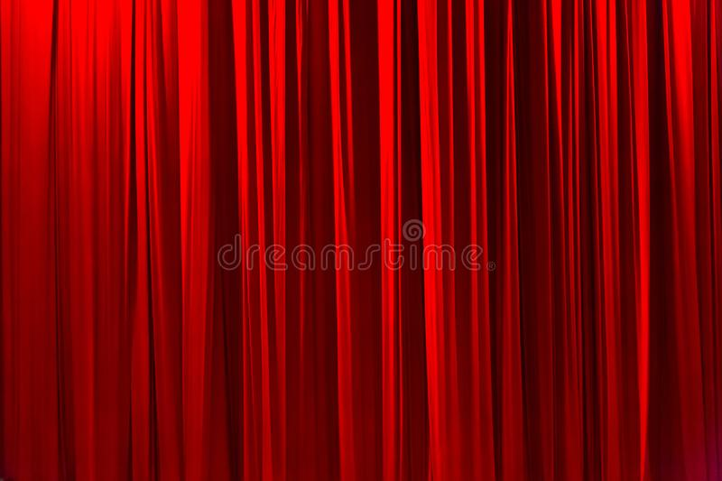 Red striped curtain in theater elegant texture background. royalty free stock photography