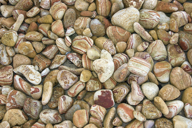 Red striped sandy pebbles