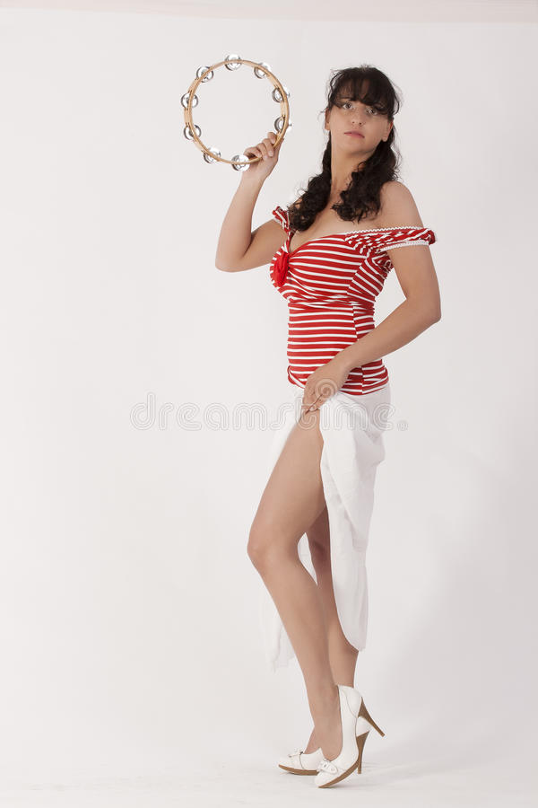 Red + Stripes. Young woman in a red skirt with white lace Ringeltop stock photos