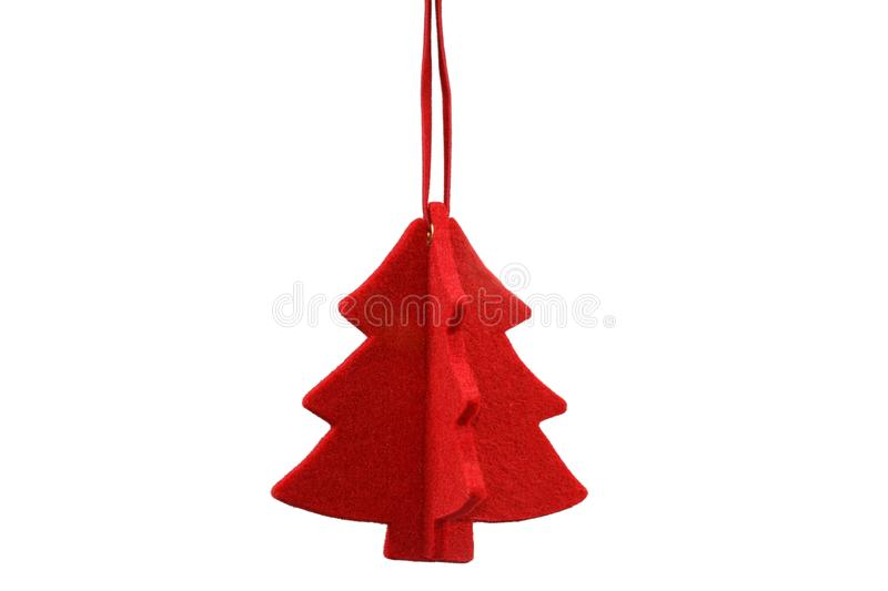 Red stylized Christmas tree. Made from felt isolated on white background stock image