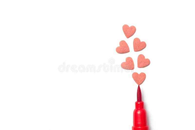 Red sugar candy sprinkles in heart shape brush pen on white paper background. Imitation of drawing illustration. Valentine. Mother`s day kids charity donation stock image