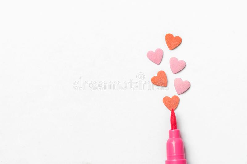Red sugar candy sprinkles in heart shape pink brush pen on white paper background. Imitation of drawing illustration. Valentine. Mother`s day kids charity royalty free stock images