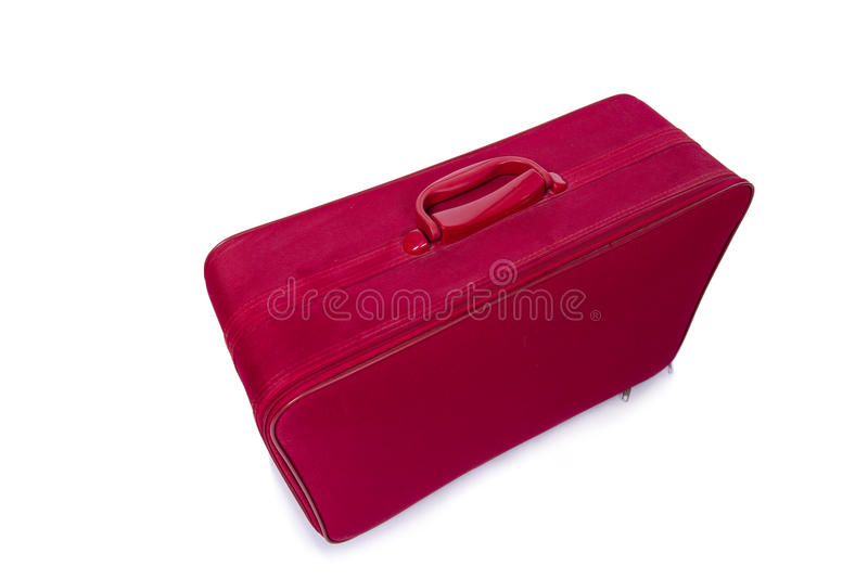 The red suitcase isolated on the white background royalty free stock image