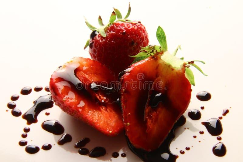 Red summer strawberries, seasonal fruit, macro photo with balsamic vinegar of Modena royalty free stock photography