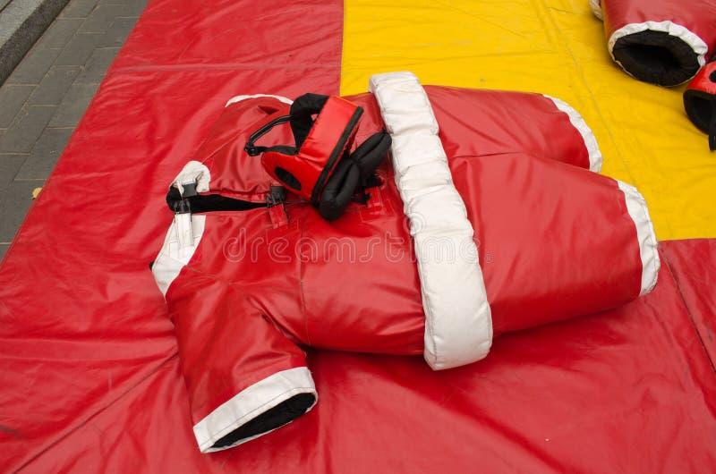 Red sumo wrestler costume suit helmet. Red sumo wrestler costume suit and helmet. People fun entertainment play object in street stock photos