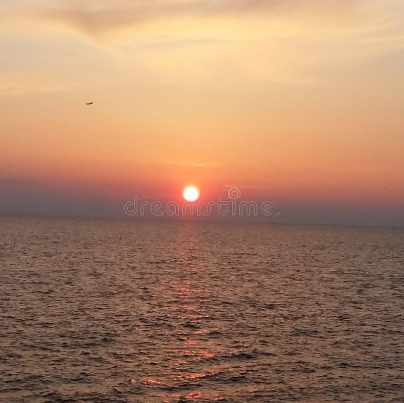 Red sun. A sunset on a mussy sea royalty free stock photo