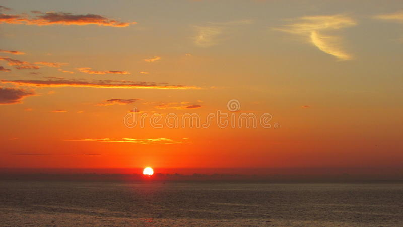 Red sunrise on the sea stock photo