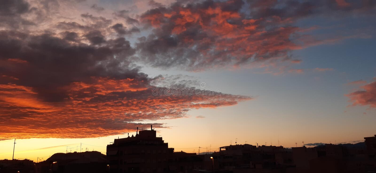 Red sunset at the city. Silluet, skyline, silhouette stock photos