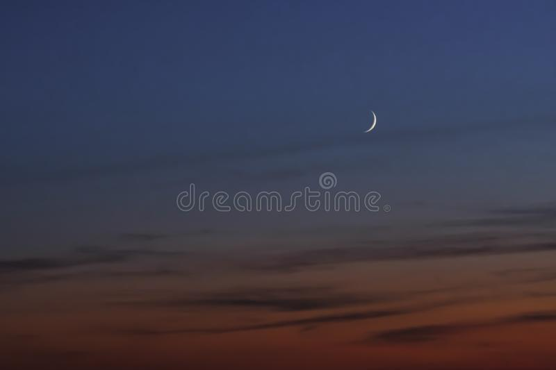 Red sunset and moon background. Against of clouds. Beautiful sky, pink clouds. royalty free stock photos