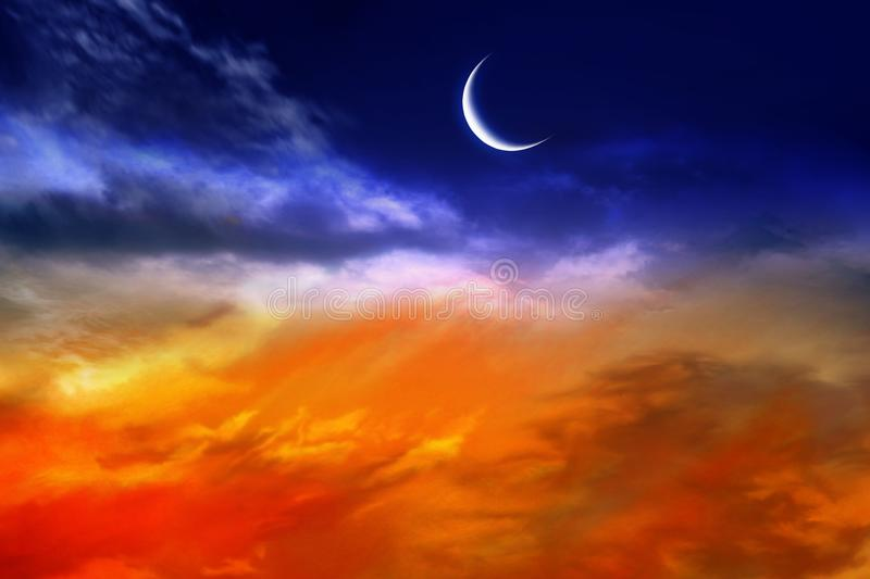 Red sunset and moon stock image