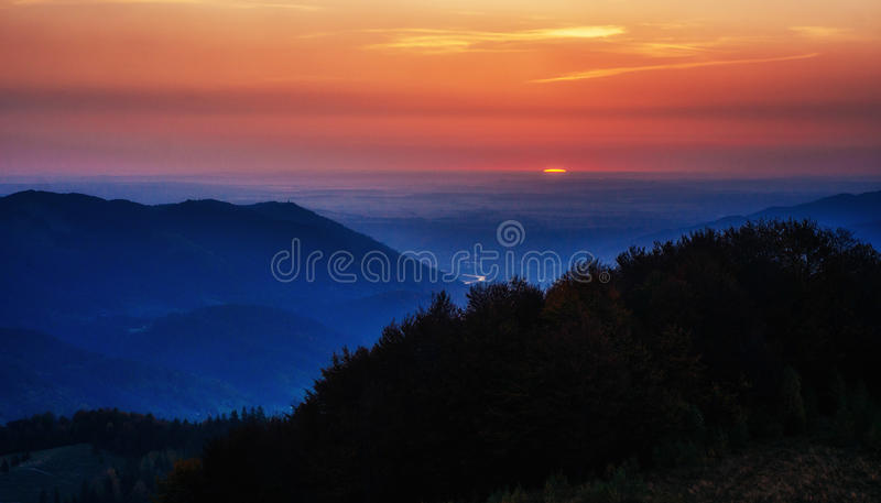 Red sunset in the mountains landscape with sunny beams. Carpathi. An, Ukraine, Europe. Instagram toning effect stock images