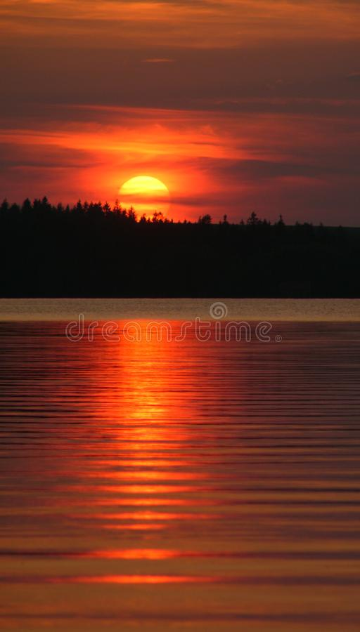Red sunset over sea or lake royalty free stock photo