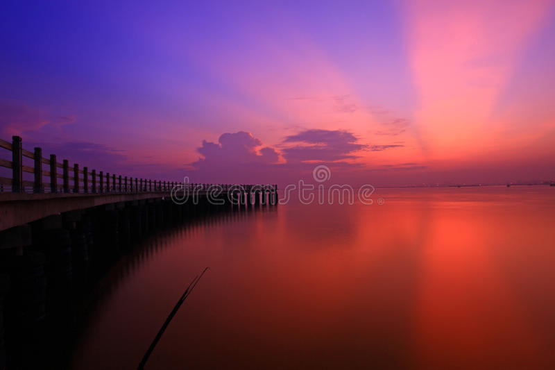 Download Red Sunset Over Sea And Pier Stock Photo - Image: 22141454