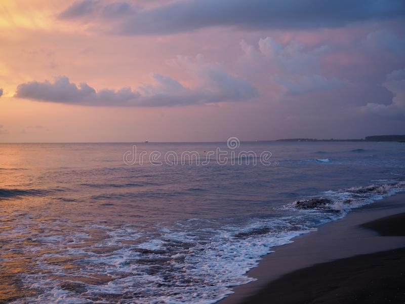 Red sunset over the sea, rich in dark clouds, rays of light royalty free stock images