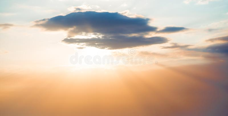 Red sunset over the sea, rich in dark clouds. Rays of light royalty free stock photo