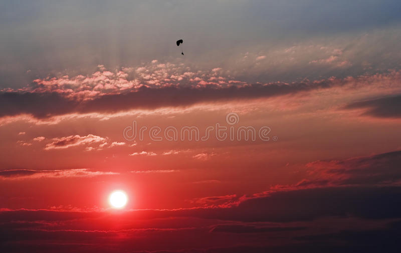 Download Red sunset with paraglider stock photo. Image of orange - 24154602