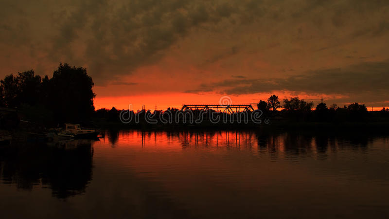 Sunset and red sky over river royalty free stock image