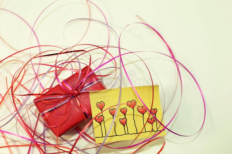 A red surprise and a yellow sticky notes. stock photo