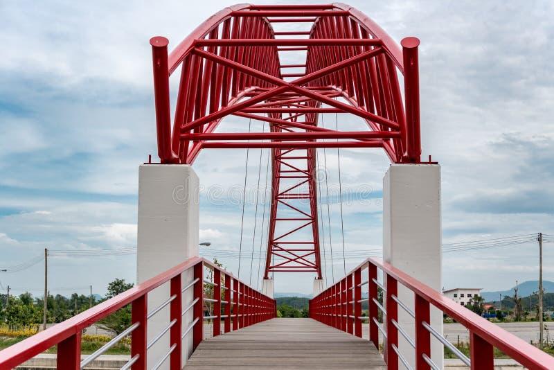 Red Suspension bridge of Laharn rai temple stock photography