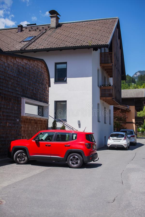 Red SUV parked near the house.  stock photos