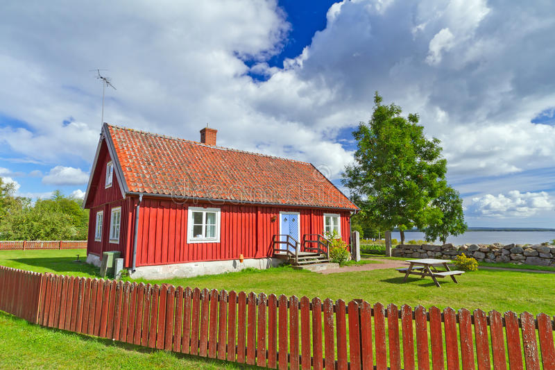 Download Red Swedish cottage house stock photo. Image of blue - 28639952
