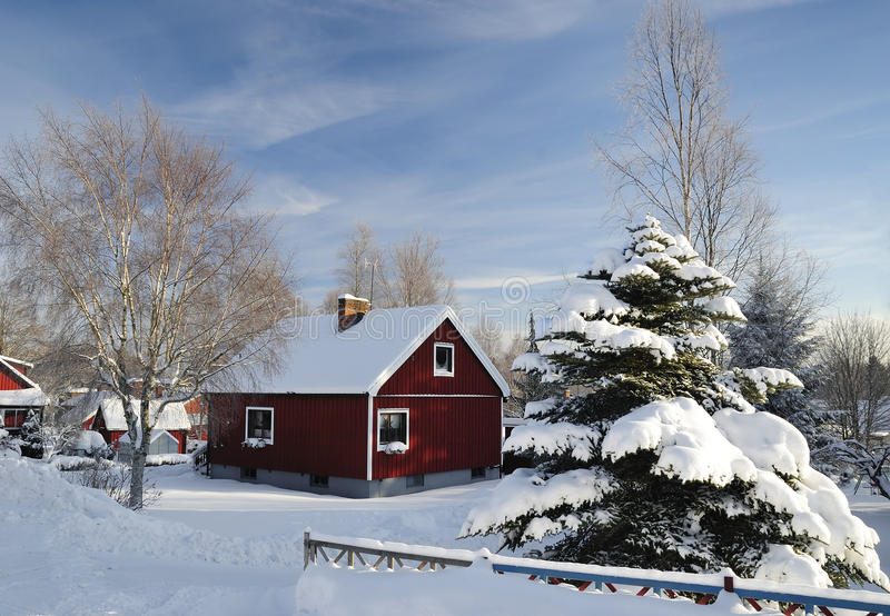 Red Swedish House In Winter Colors Stock Photo