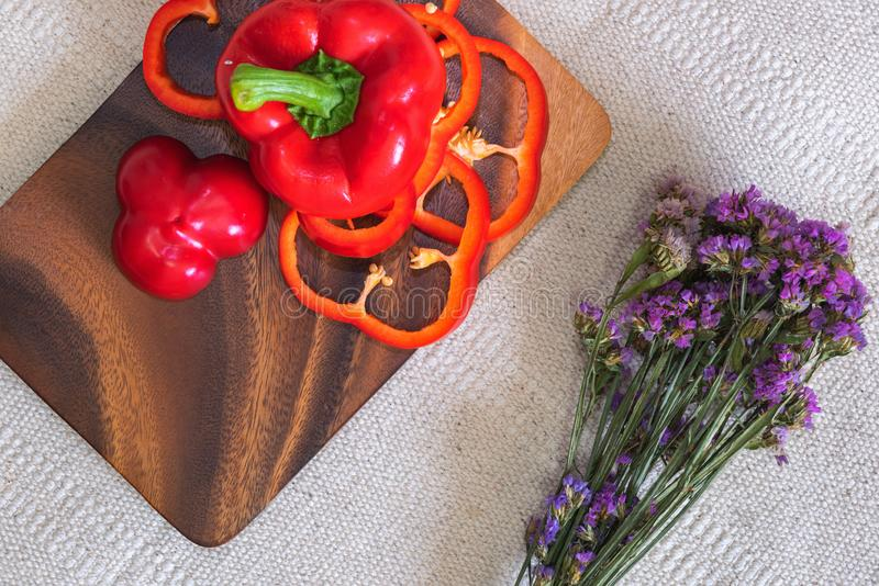 Red Sweet Peppers in a Wooden Bowl, Raw Organic Vegetable on a Table Ready to Cooking in The Kitchen Room. Ingredient Food royalty free stock photography