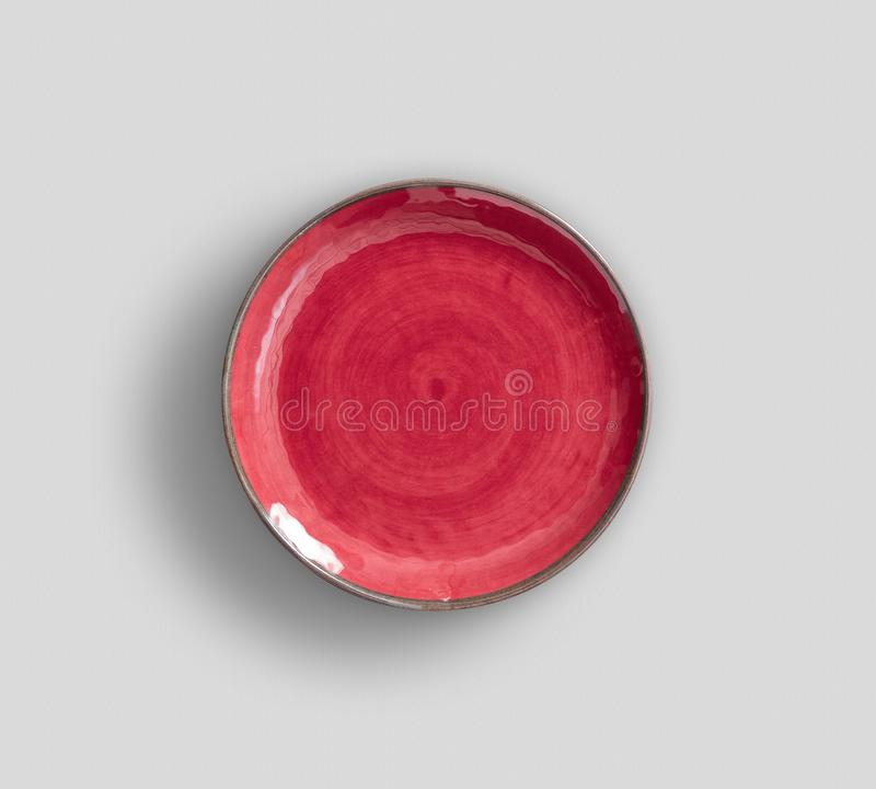 Red Swirl Melamine Plate with dark gray background stock images
