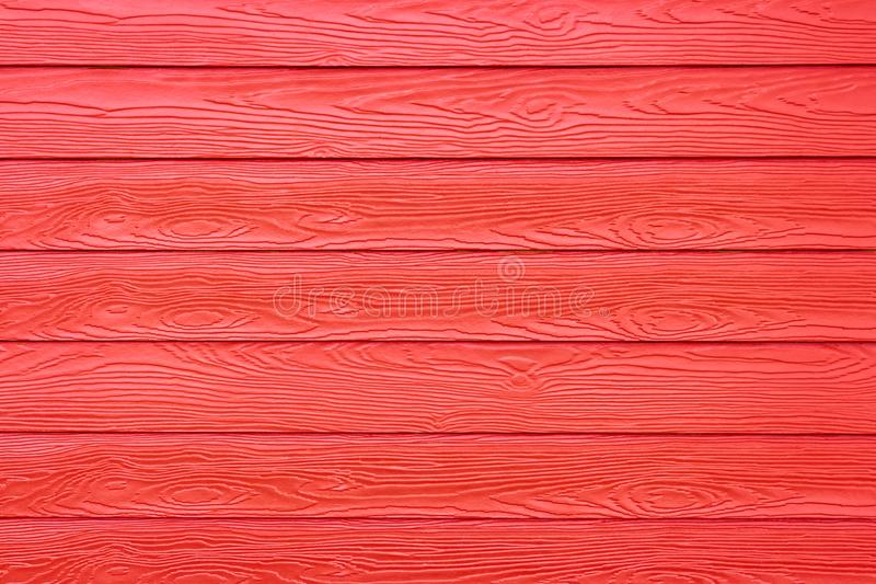 Red synthetic wood texture wall house. royalty free stock photography