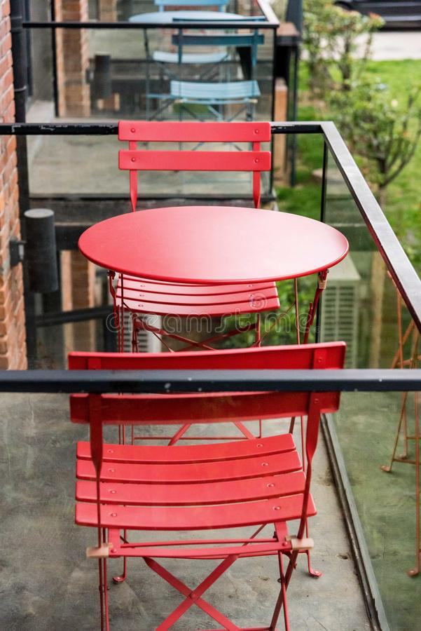 Red tables and chairs on the balcony. Closeup of red tables and chairs on the balcony of a hotel stock photography