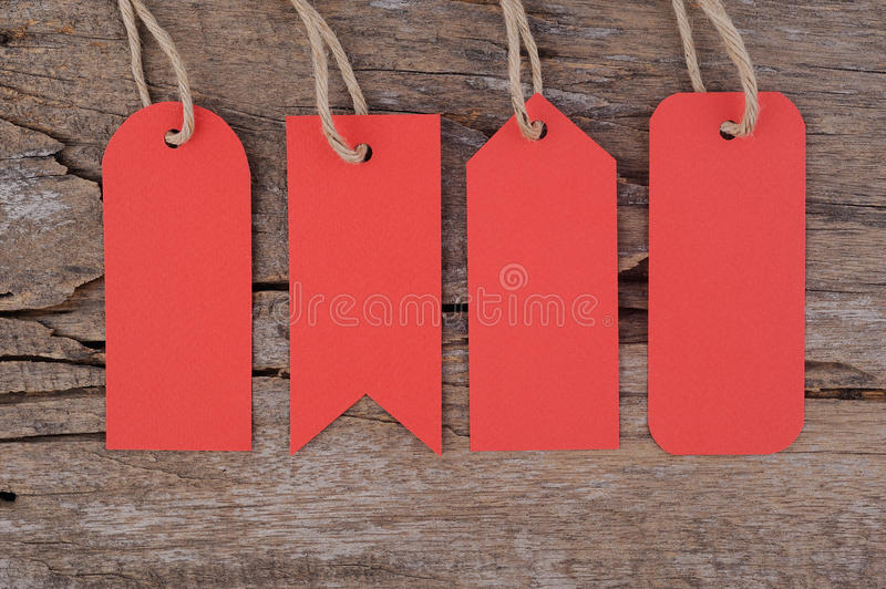 4 Red tags on Wood table for sale and text. 4 Red tags on Wood table for text royalty free stock images
