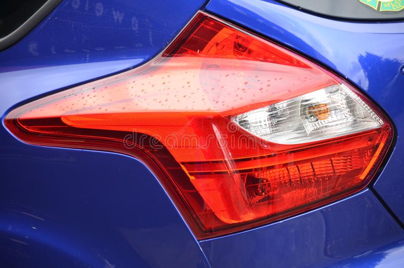 Download Red Tail Light on Blue Car stock image. Image of contur - 104285283