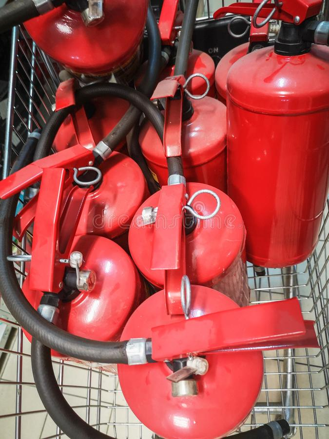 Red tank of fire extinguisher. Overview of a powerful industrial fire extinguishing system. Emergency equipment for industrial stock photography