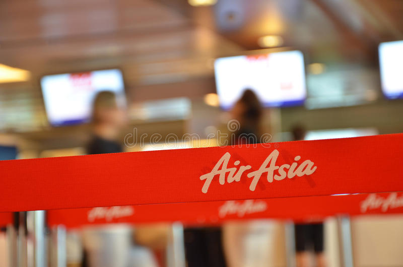 Red tape with Airasia inscription in Changi Airport, Singapore. SINGAPORE - 18 NOV, 2016: Red tape with Airasia inscription in Changi Airport, Singapore. AirAsia stock photos