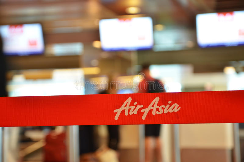 Red tape with Airasia inscription in Changi Airport, Singapore. SINGAPORE - 18 NOV, 2016: Red tape with Airasia inscription in Changi Airport, Singapore. AirAsia royalty free stock photos