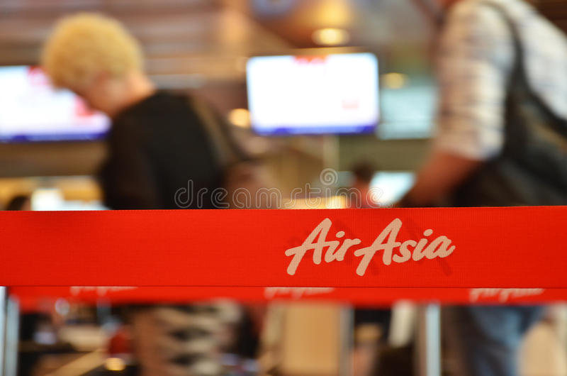 Red tape with Airasia inscription in Changi Airport, Singapore. SINGAPORE - 18 NOV, 2016: Red tape with Airasia inscription in Changi Airport, Singapore. AirAsia stock photography