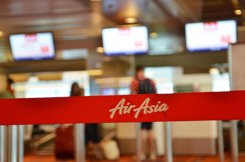 Red tape with Airasia inscription. SINGAPORE - 18 NOV, 2016: Red tape with Airasia inscription in Changi Airport, Singapore. AirAsia Berhad is a Malaysian low stock images