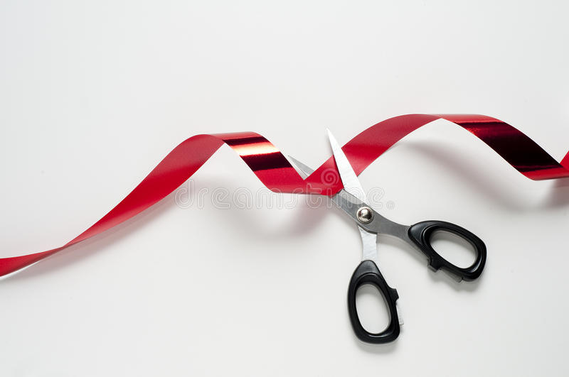 Red tape. Cut the red tape with the scissors royalty free stock image