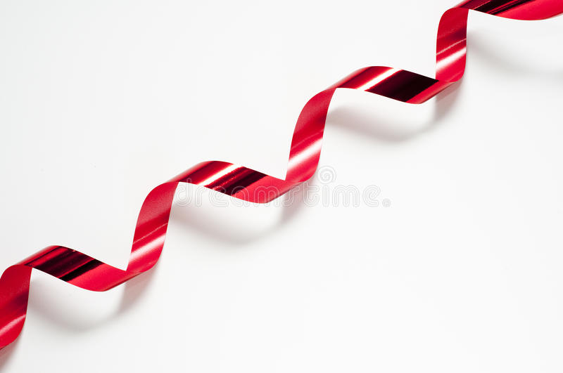 Red tape. Cut the red tape with the scissors royalty free stock images