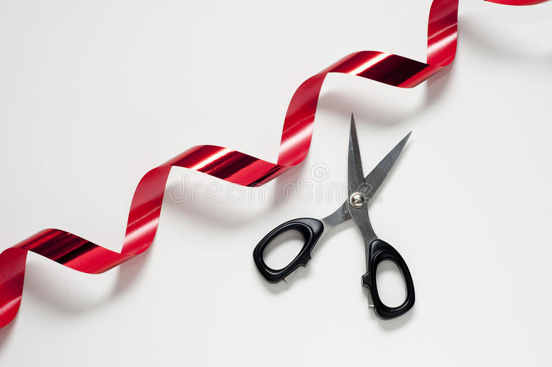 Red tape. Cut the red tape with the scissors stock images