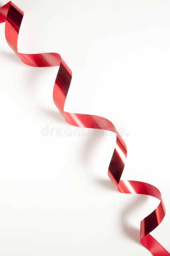 Red tape. Cut the red tape with the scissors stock photography