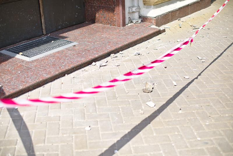 Red tape overlap by police entrance, building collapse, incident, ruin, news, stones on road stock photos