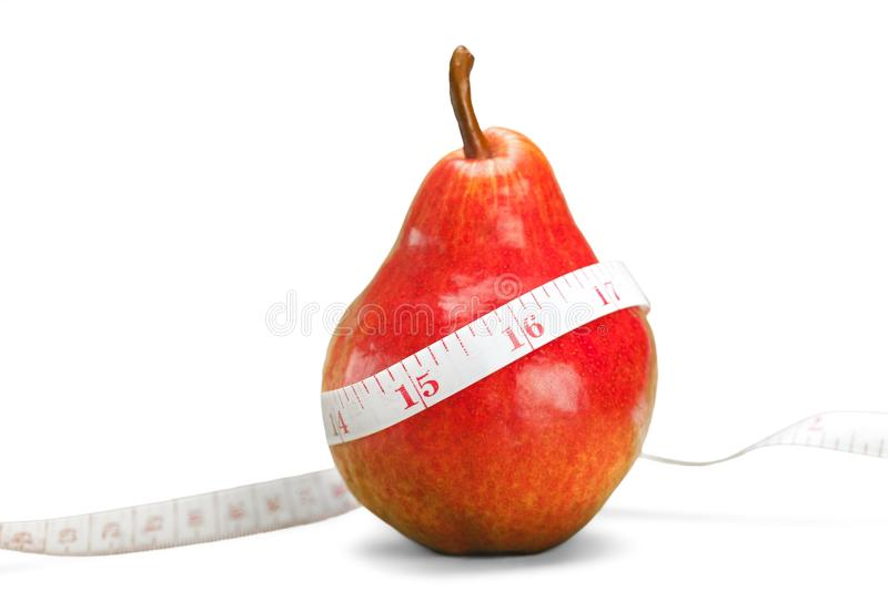 Red fresh pear with tape on white background royalty free stock image