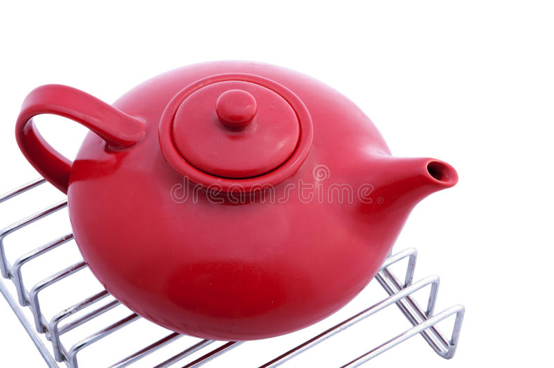 Red Teapot On Stainless Grill Royalty Free Stock Photography