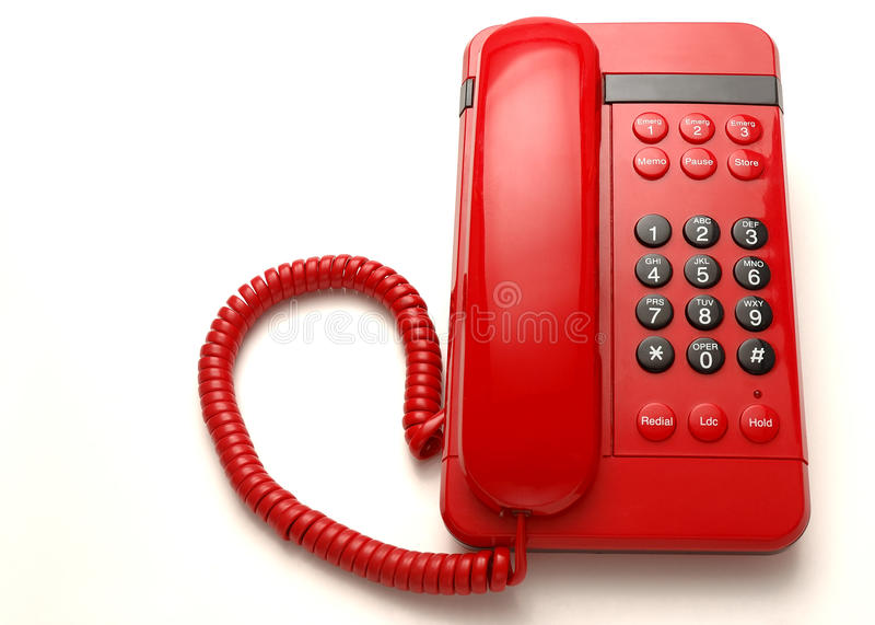Red telephone. Red retro style telephone, isolated on white background stock photo