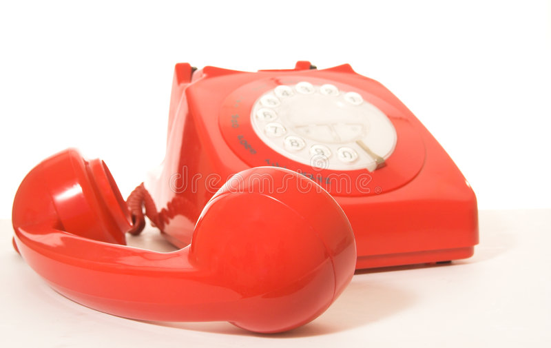 Red telephone. Shallow DOF focus on handset royalty free stock image