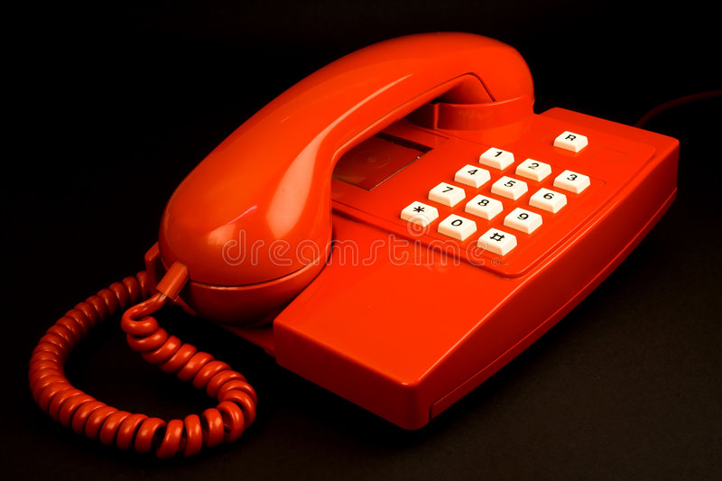 Red telephone. Isolated on black royalty free stock image