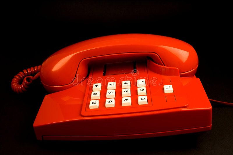 Red telephone. Isolated on black royalty free stock photos