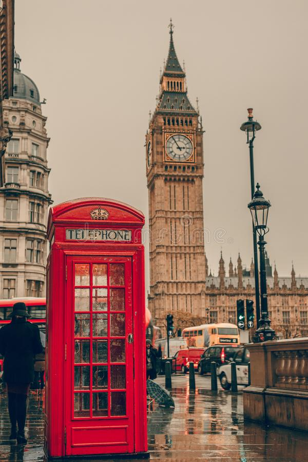 Red telephone booth and Big Ben. London, UK. London Scene with Big Ben, London Double Decker Bus and Red Telephone Box royalty free stock photography